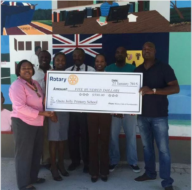 Rotary Club of Providenciales with Rotaract Club of Providenciales, Turks and Caicos donating to Oseta Jolly Primary School