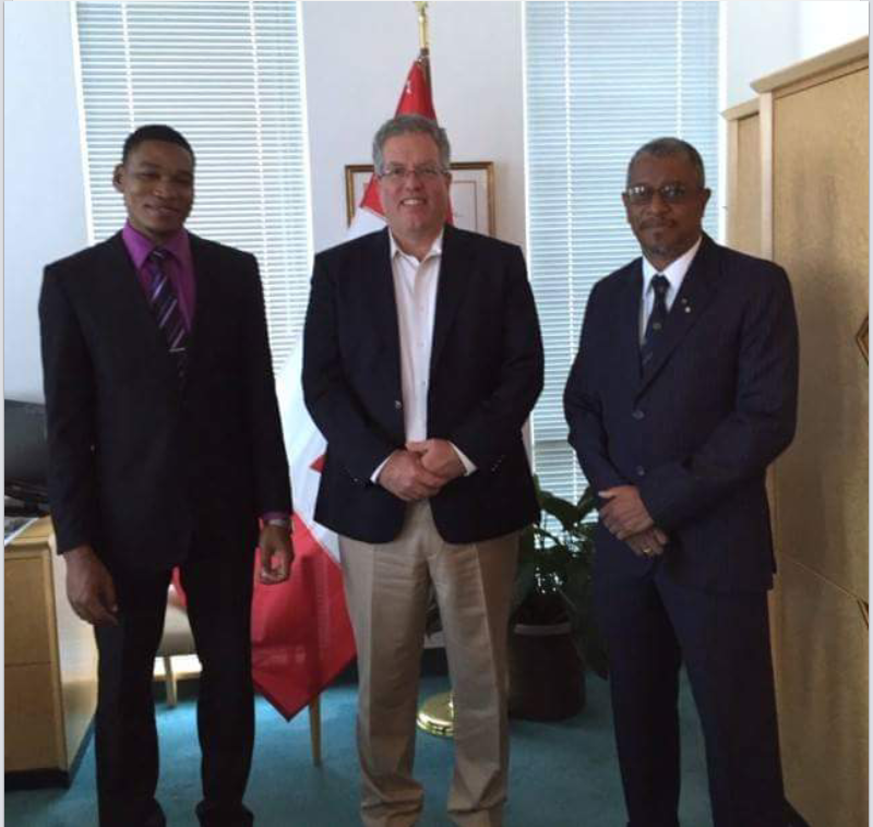 AfC Chairman, Col. Stacey Thompson (R) and Project Coordinator, Brandon McFarlane (L) pay a courtesy visit to Canadian High Commissioner to Jamaica, Mr. Robert Ready (C) after securing support from the Canadian DFATD earlier in April '15.